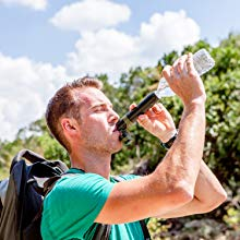 The Survivor Filter water filter can be attached to water bottles to carry water on the go.